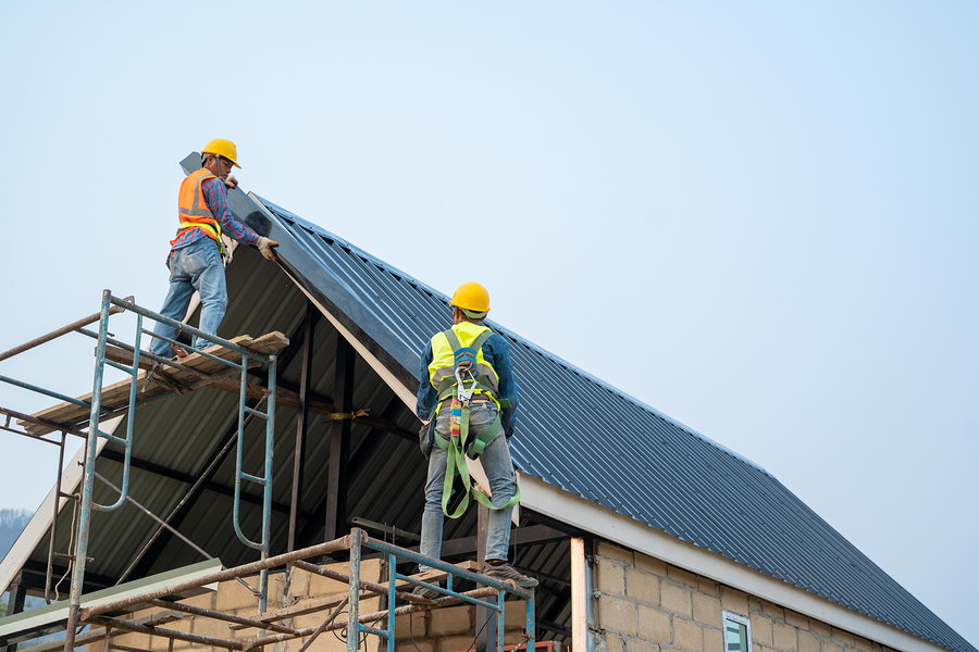 men working the roof