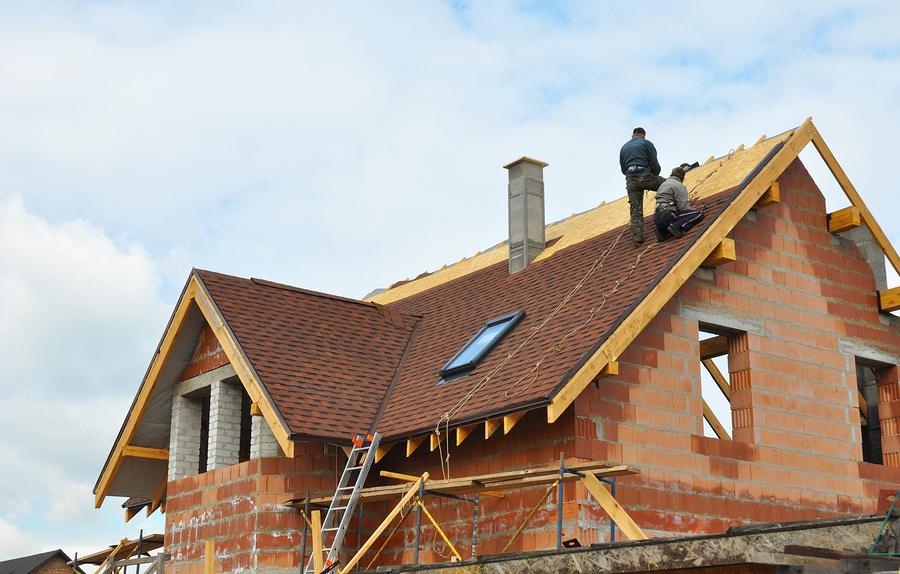 men installing a roof