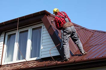 man working the house roof