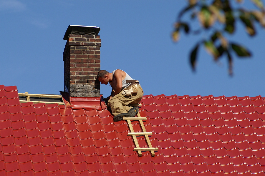 man checking the roof